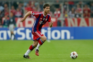 MUNICH, GERMANY - SEPTEMBER 17:  Xabi Alonso of FC Bayern Muenchen runs with the ball during the UEFA Champions League Group E match between Bayern Munchen and Manchester City at the Allianz Arena on September 17, 2014 in Munich, Germany.  (Photo by Alexander Hassenstein/Bongarts/Getty Images)